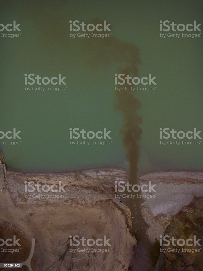 River Polluting Into Lake stock photo