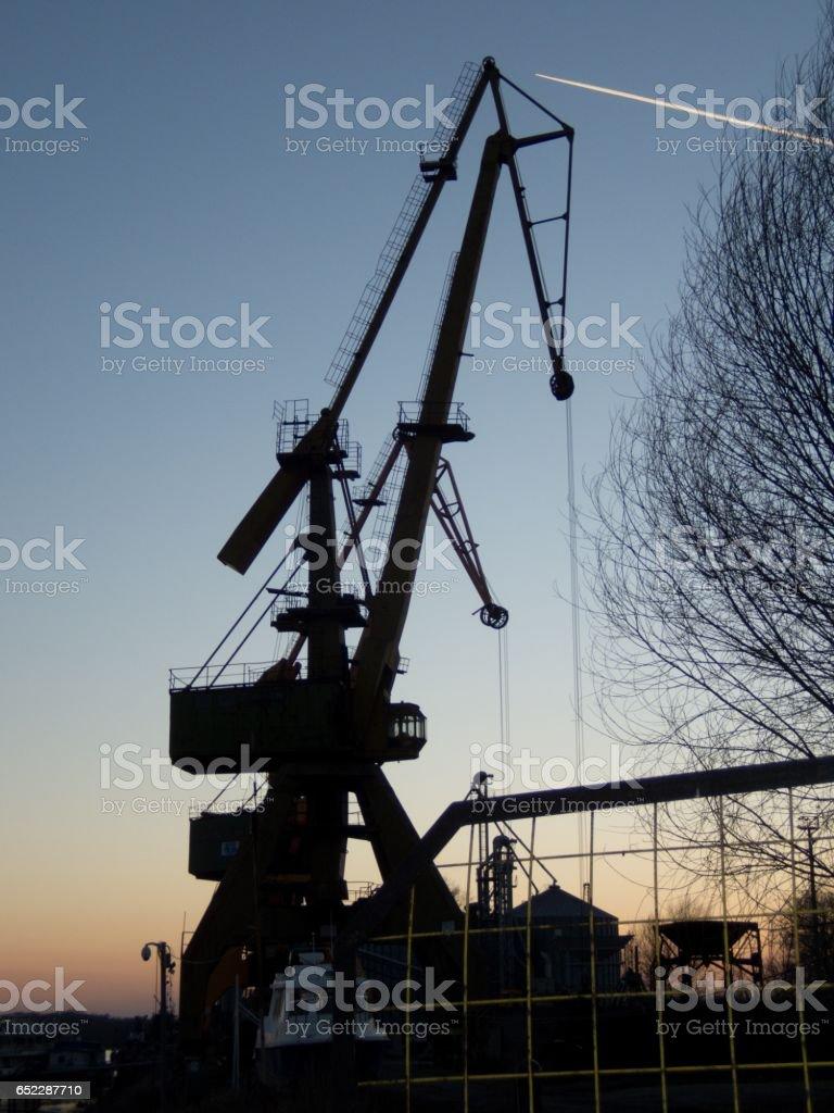 river port crane at the sunset in giurgiu stock photo