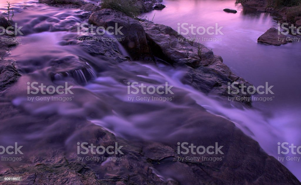 River rapids and waterfall at dusk stock photo