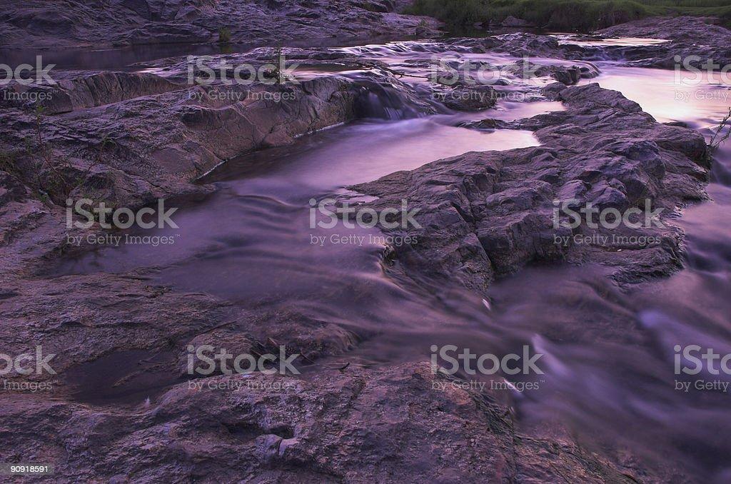 River rapids at dusk stock photo