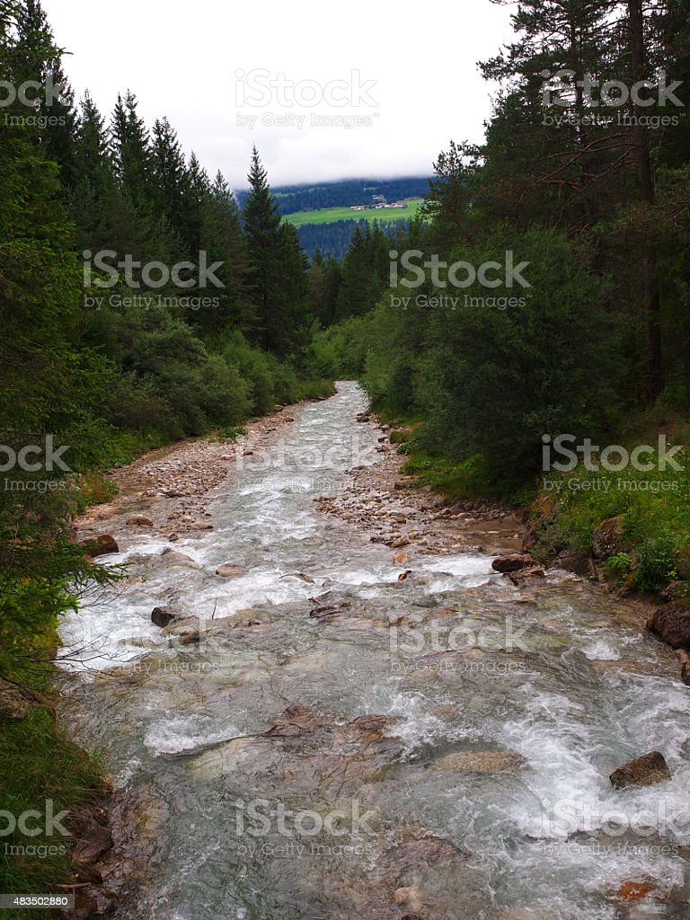 River Rienza flouting out of Toblach Lake stock photo