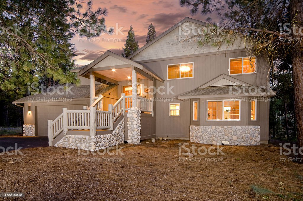 River rock accent on home in the woods royalty-free stock photo
