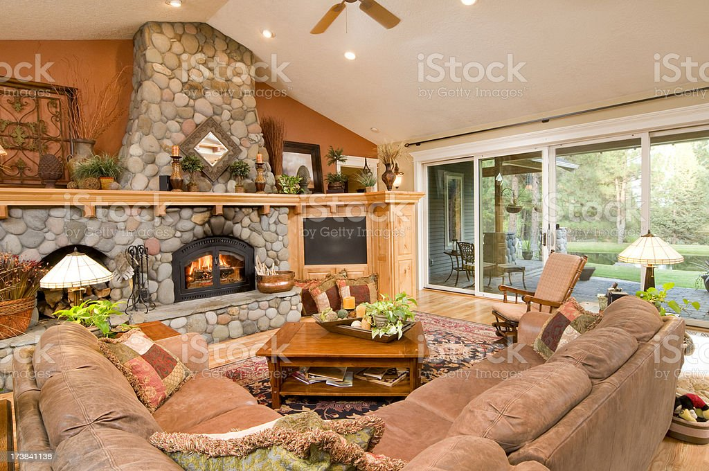 River rock fireplace in living room stock photo