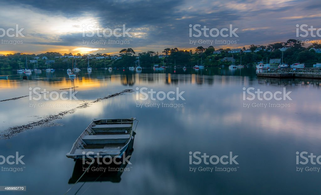 River scape at dawn, boat in forground stock photo