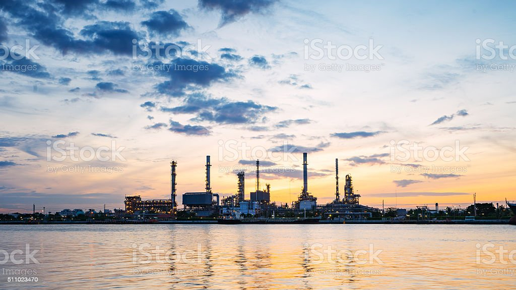 river side oil refinery industry plant along twilight morning stock photo