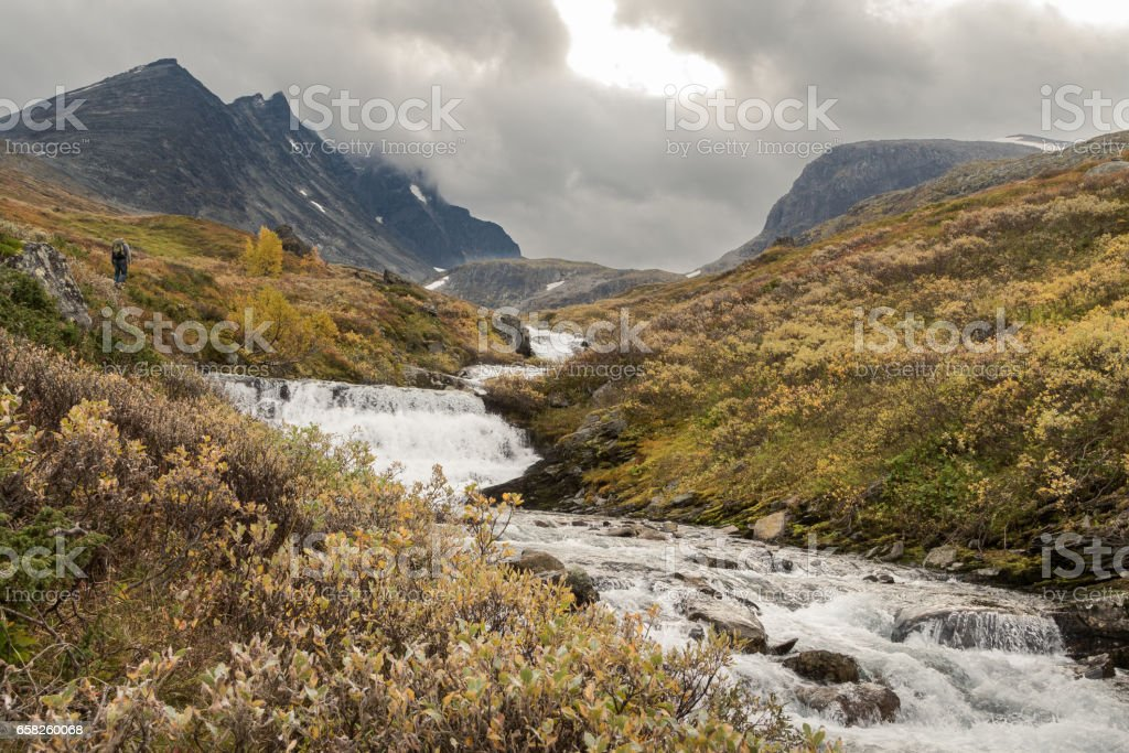 River stream coming down from the mountains of Hurrungane in Jotunheimen, Norway stock photo