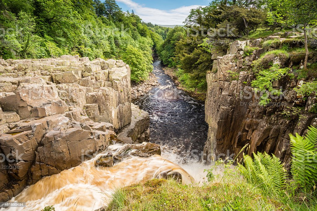 River Tees flows over High Force stock photo
