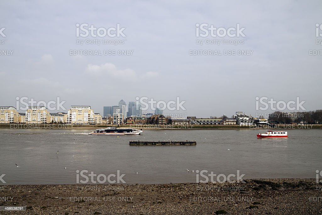 River Thames, Canary Wharf and passenger craft stock photo