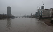River Thames in central London, in a grey foggy morning