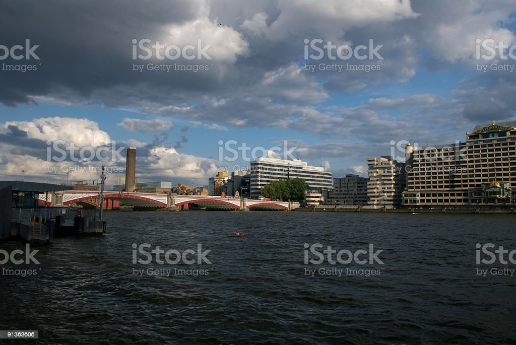 River Thames Red Bridge in London royalty-free stock photo