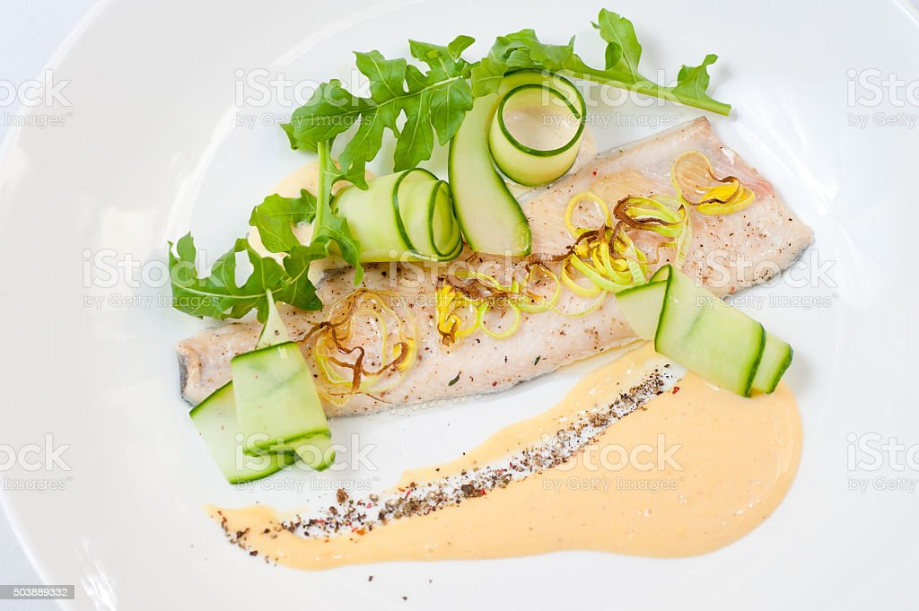 River Trout Pouched in Wine Under Sauce Hollandaise stock photo