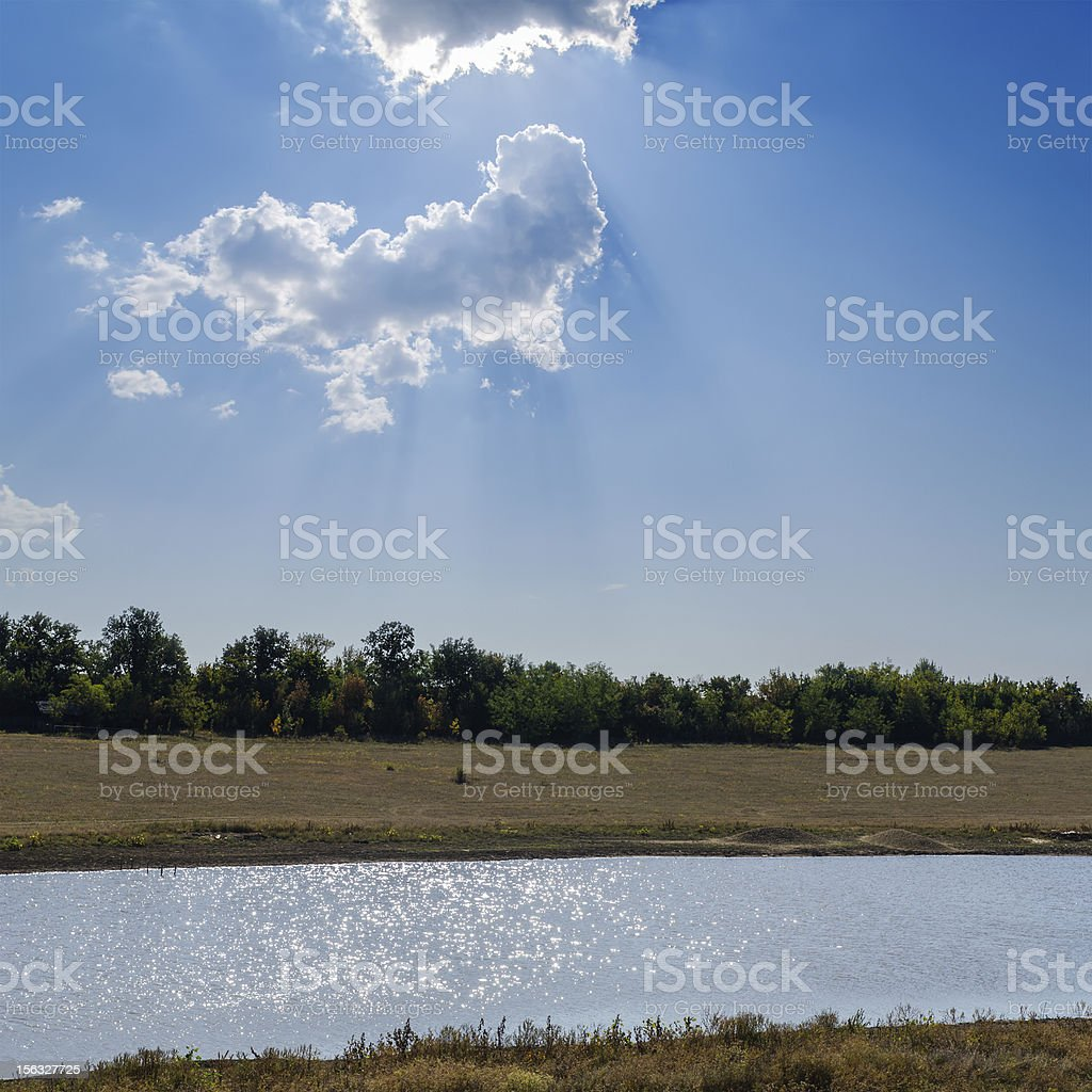 river under sunny sky with clouds royalty-free stock photo