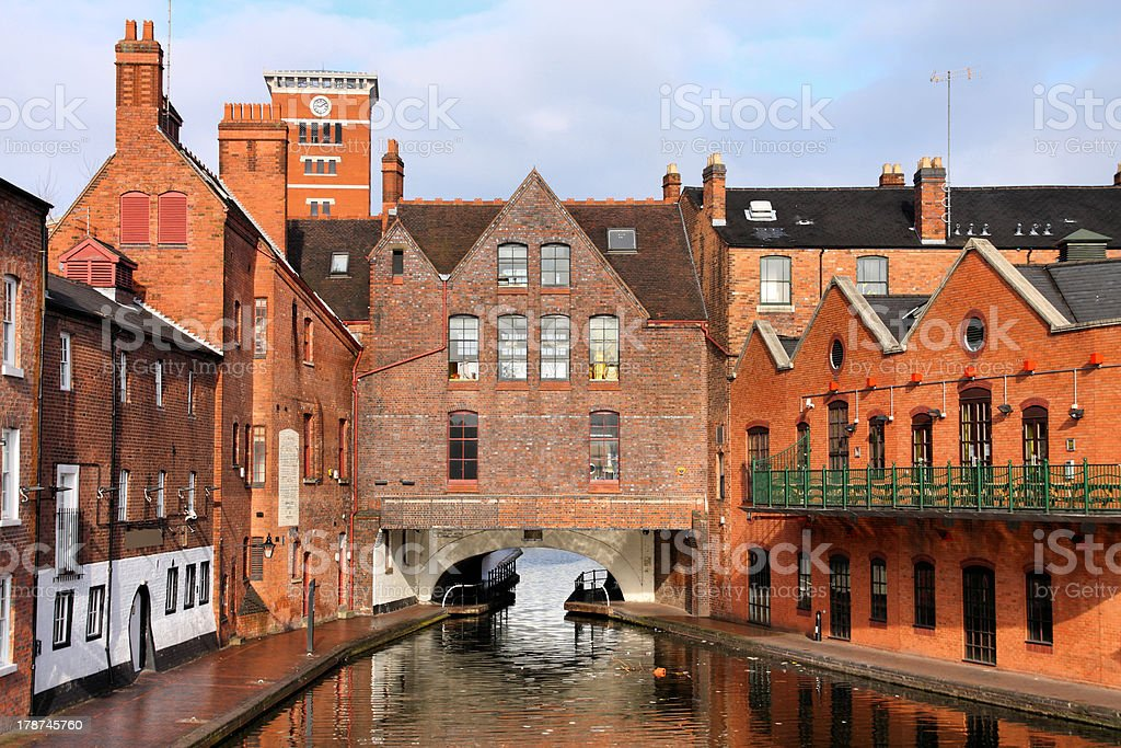 A river view of red brick buildings in Birmingham stock photo