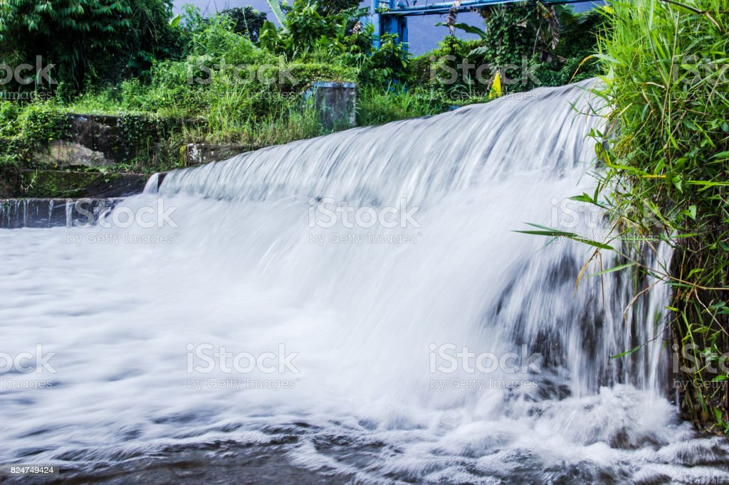 River with a small waterfall stock photo