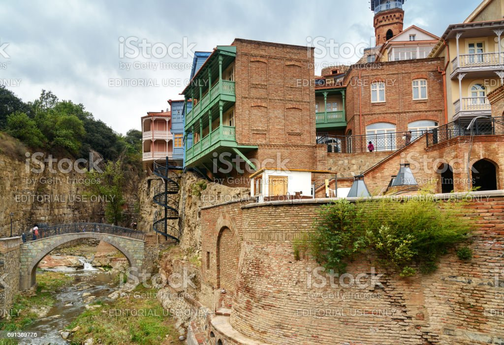 River with bridge and houses in Abanotubani district in the Old Town of Tbilisi. Georgia stock photo