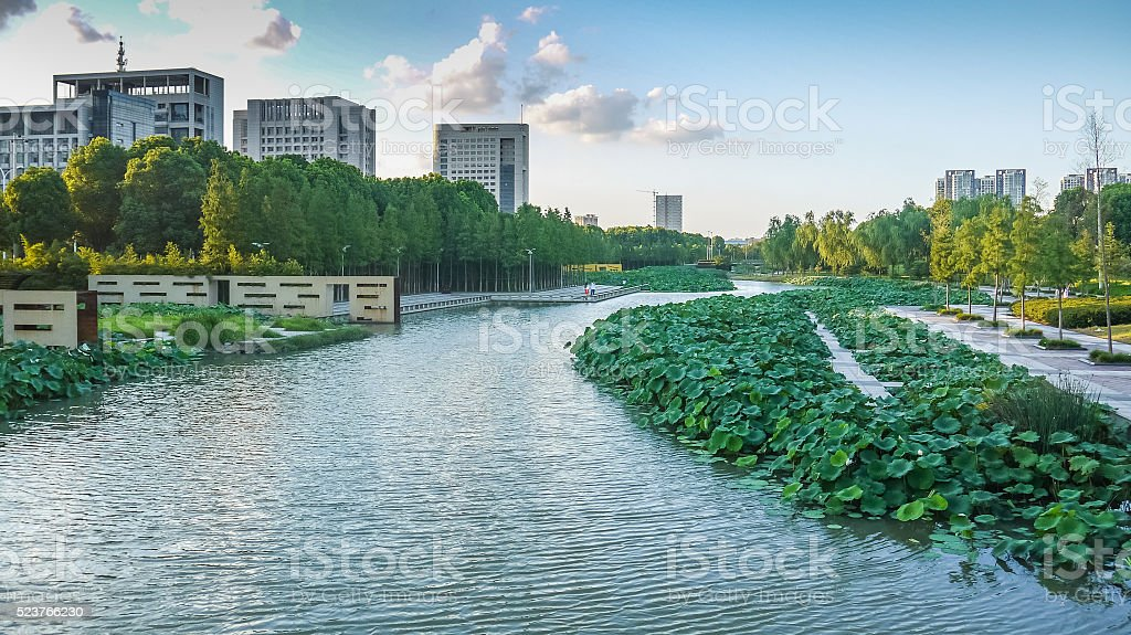 River with waterside deck and greening bank in Ningbo city stock photo