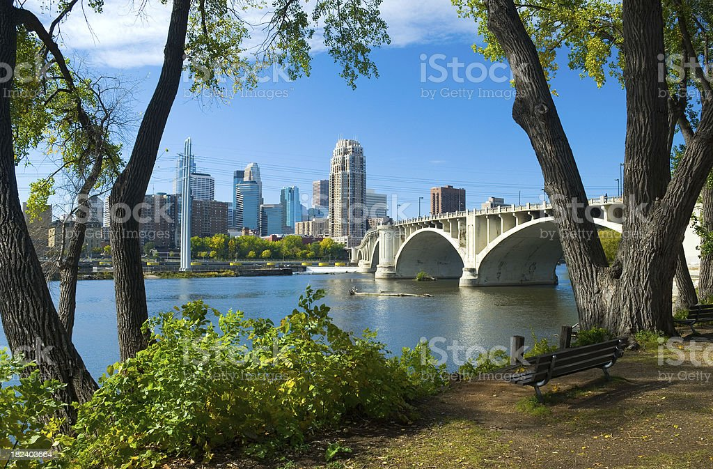 Riverbank park, Mississippi River, and Minneapolis downtown skyline royalty-free stock photo