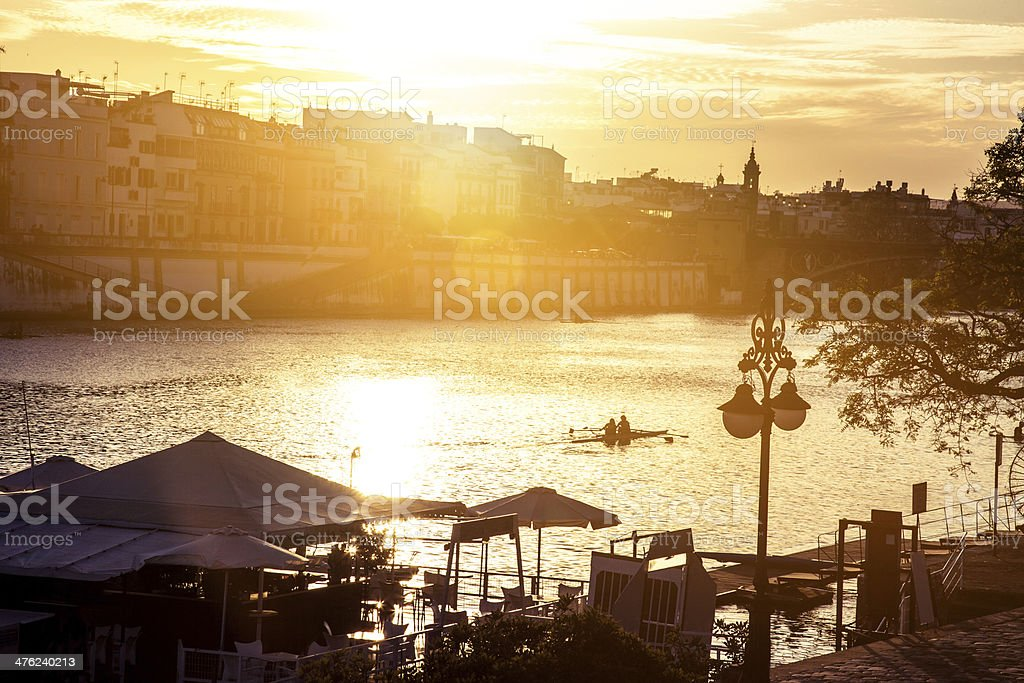 Riverbank walking at dusk in Seville stock photo