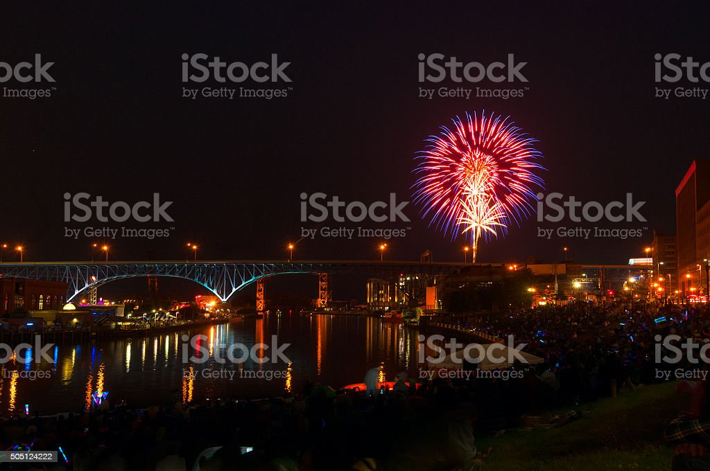 Crowds along the Cuyahoga River in downtown Cleveland Ohio watch as...