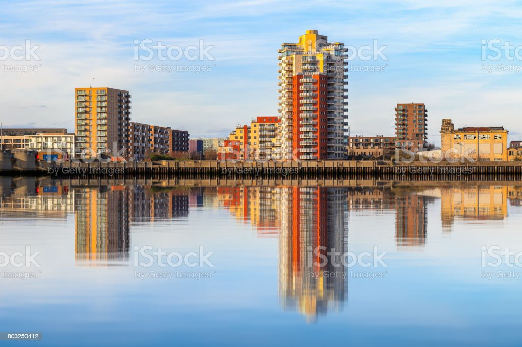 Riverside apartment next to Thames Barrier with its reflection from river Thames stock photo