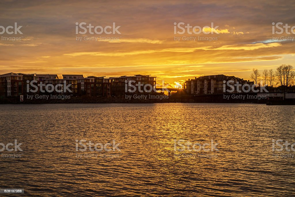 riverside apartments silhouette at sunset stock photo