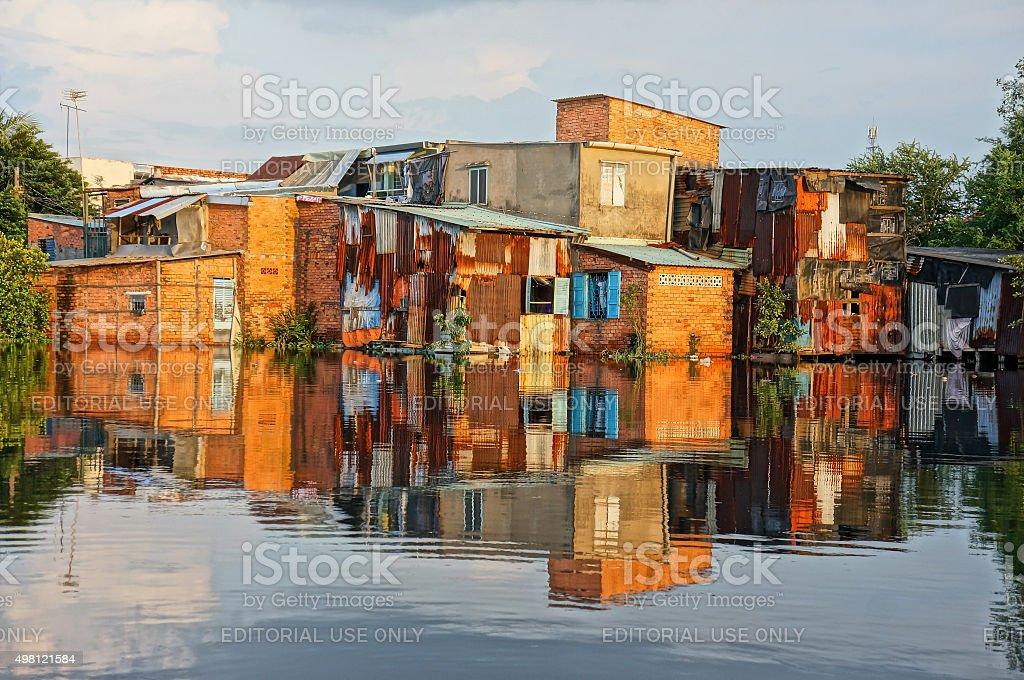 riverside downgrade house, brick wall, poor stock photo