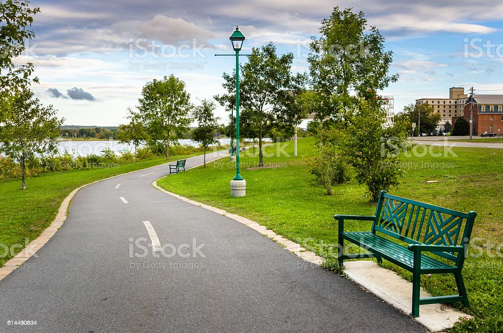 Riverside Paved Path and Cloudy Sky stock photo