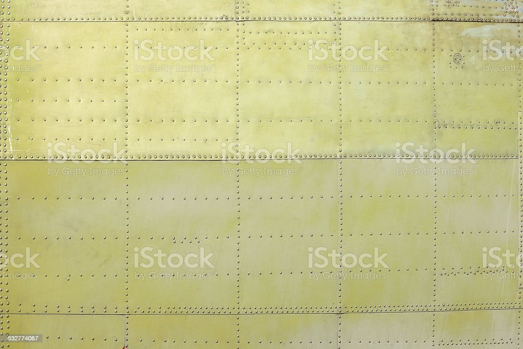 riveted khaki background stock photo
