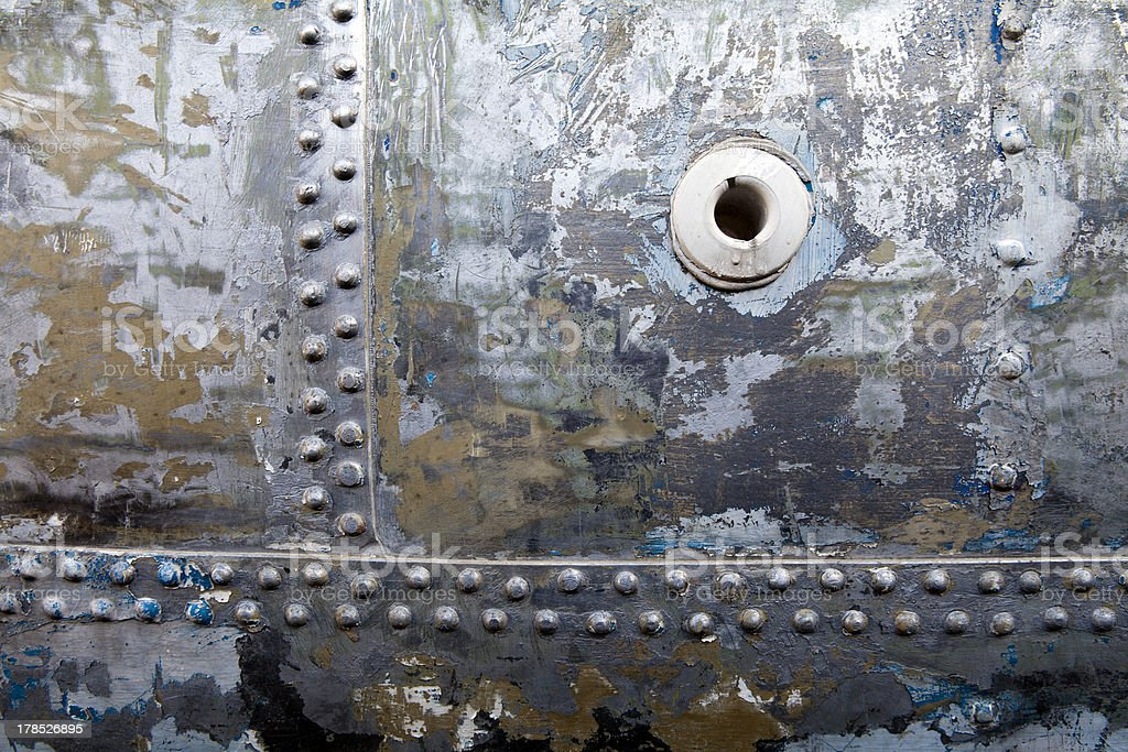 Riveted sections on the side of ship hull royalty-free stock photo