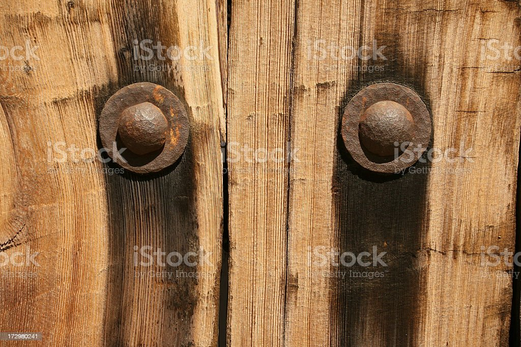 Rivets in an Old Fence stock photo