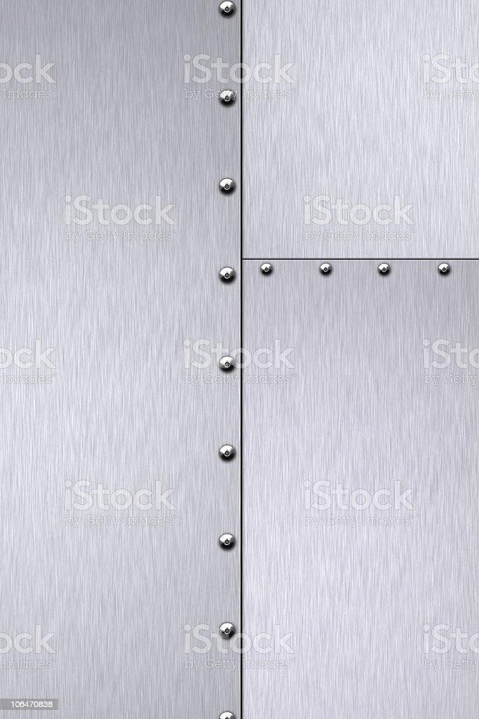 Rivets in brushed metallic steel royalty-free stock photo