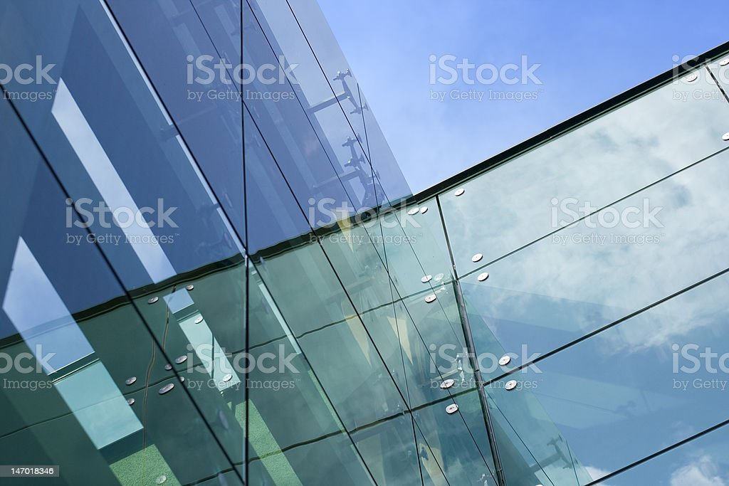 rn glass building - sky and clouds reflection royalty-free stock photo