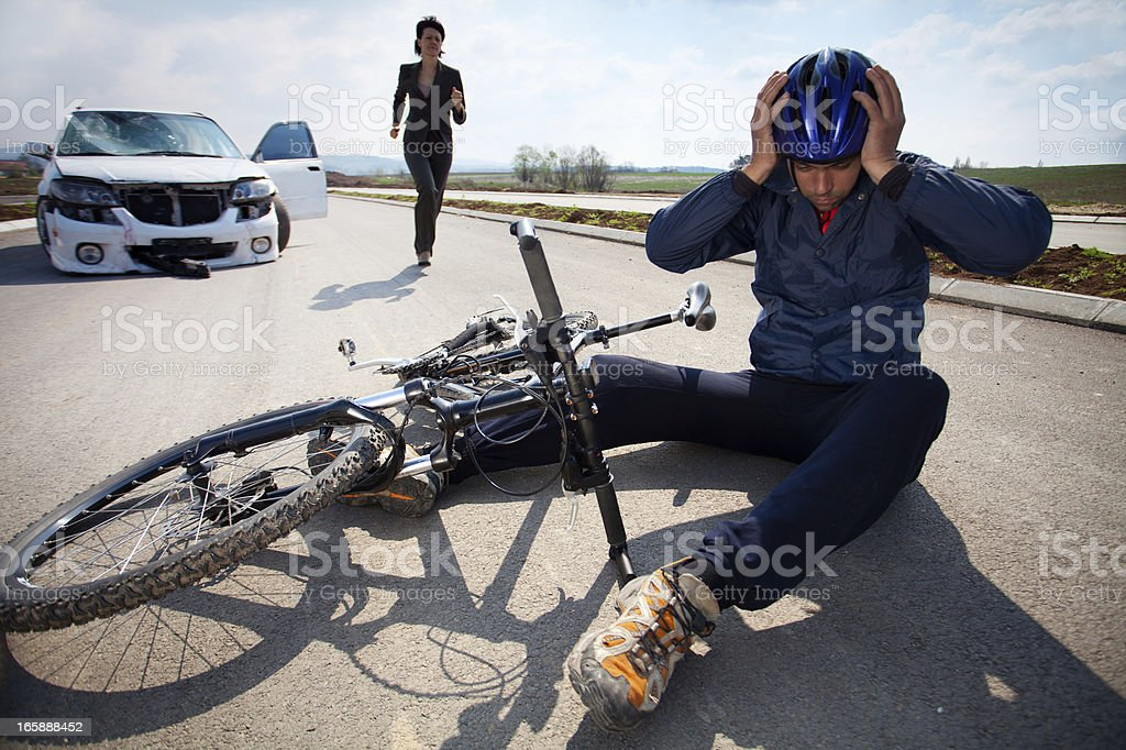 Road accident. Car and bicycle stock photo