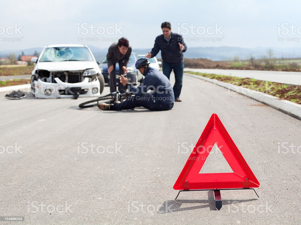 Road accident. Cyclist and a car royalty-free stock photo