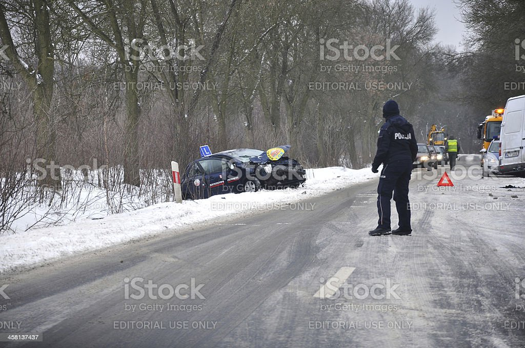 road accident - policeman directs traffic stock photo