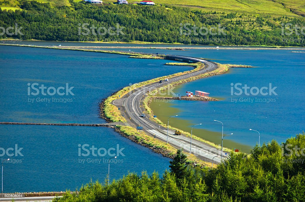 Road accross fjord near airport and city of Akureyri stock photo