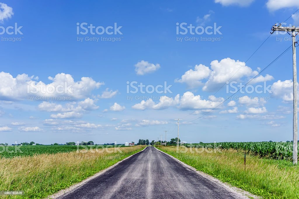 Road across corn country stock photo