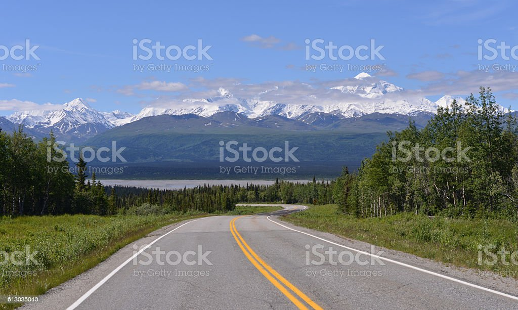 Road across wilderness, Alaska stock photo