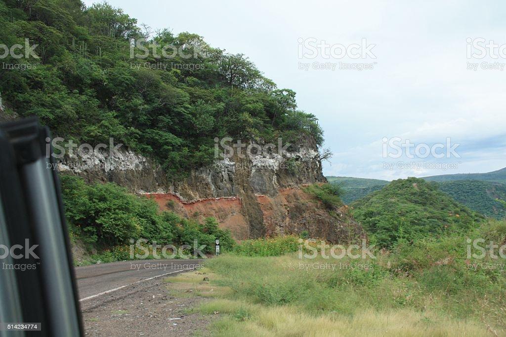 Road along a beautiful hill stock photo