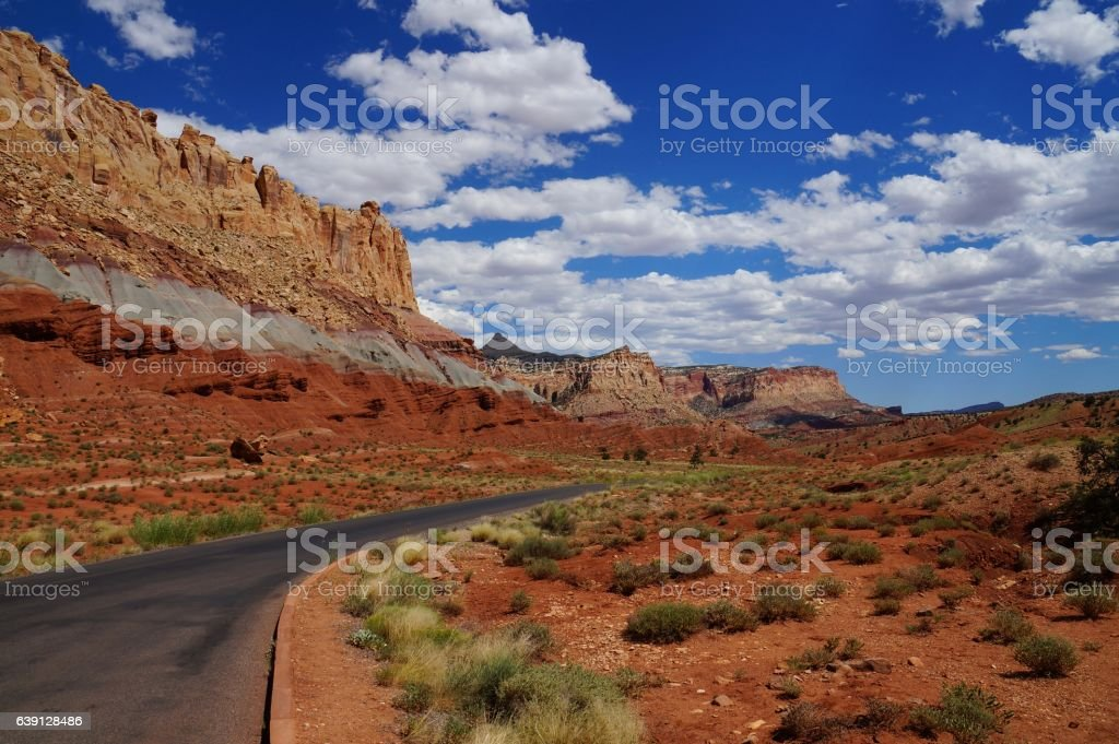 Road along a tilted geologic fold, sequence of sedimentary rock stock photo