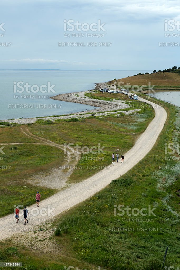 Road along seaside with some walkers stock photo