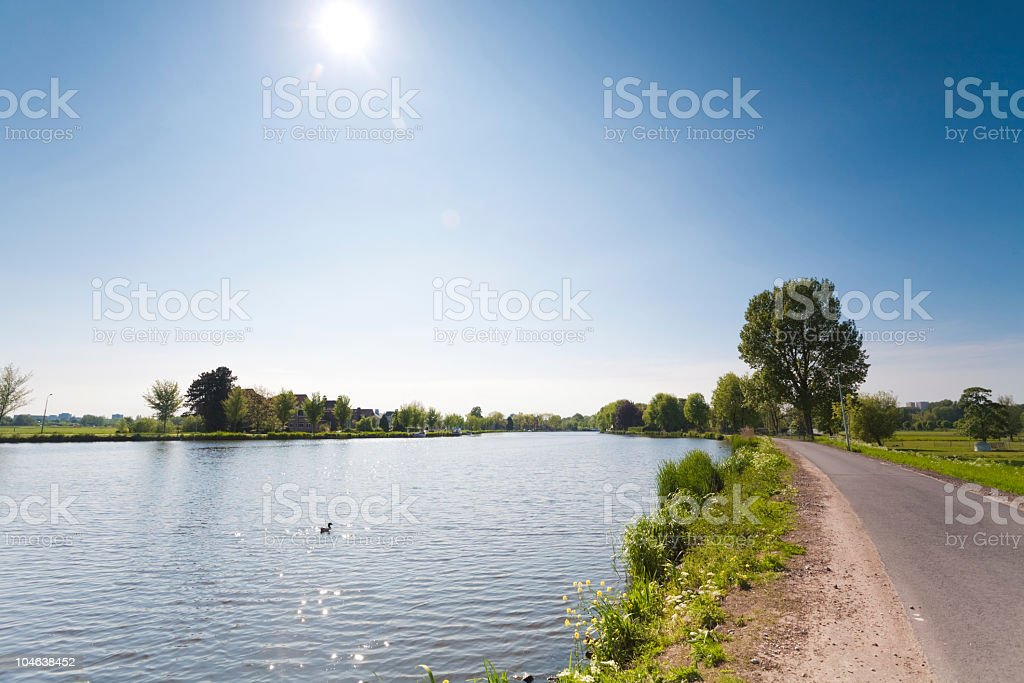 road along the amstel river royalty-free stock photo