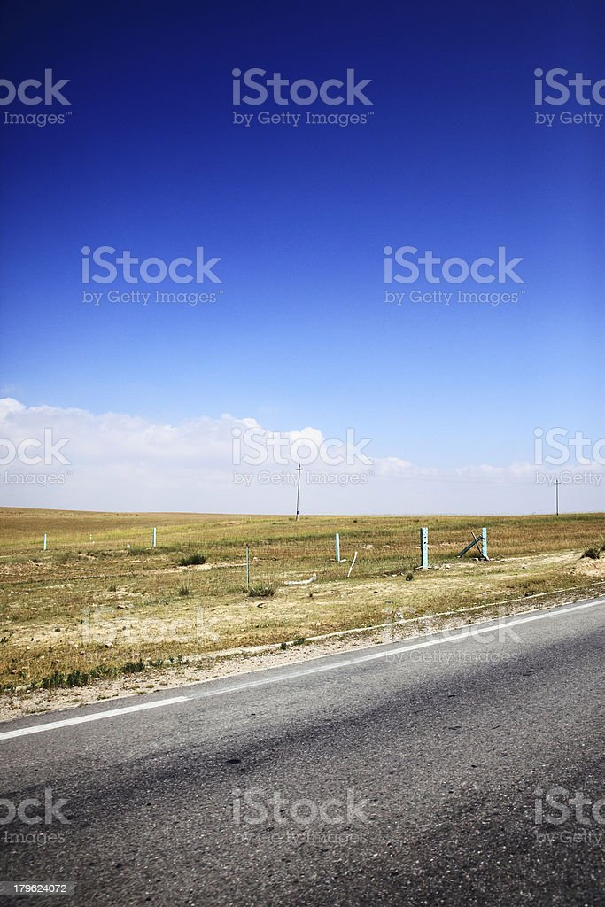 road and blue cloudy sky royalty-free stock photo