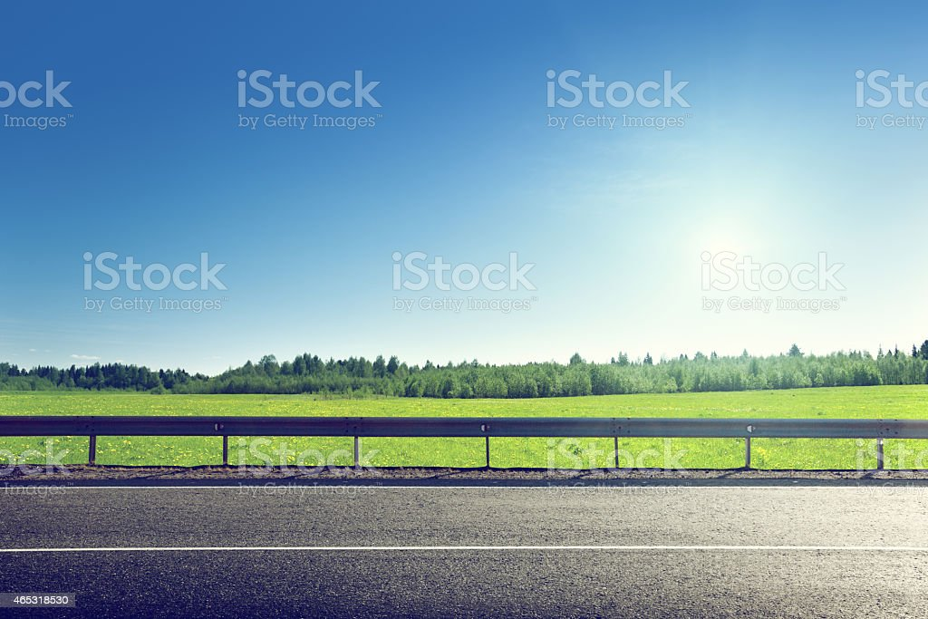 road and field of spring grass stock photo
