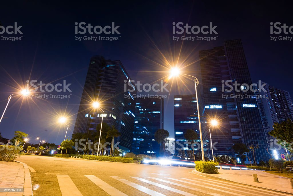 Road and modern building at night stock photo