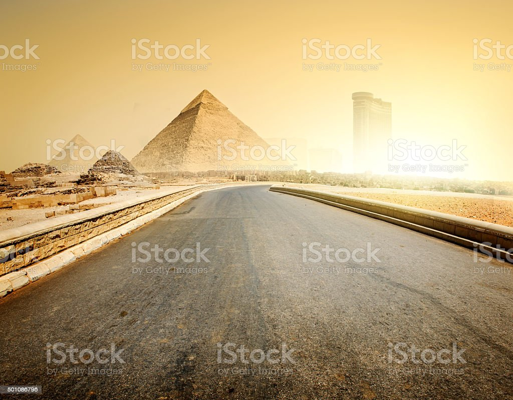 Road and pyramids stock photo