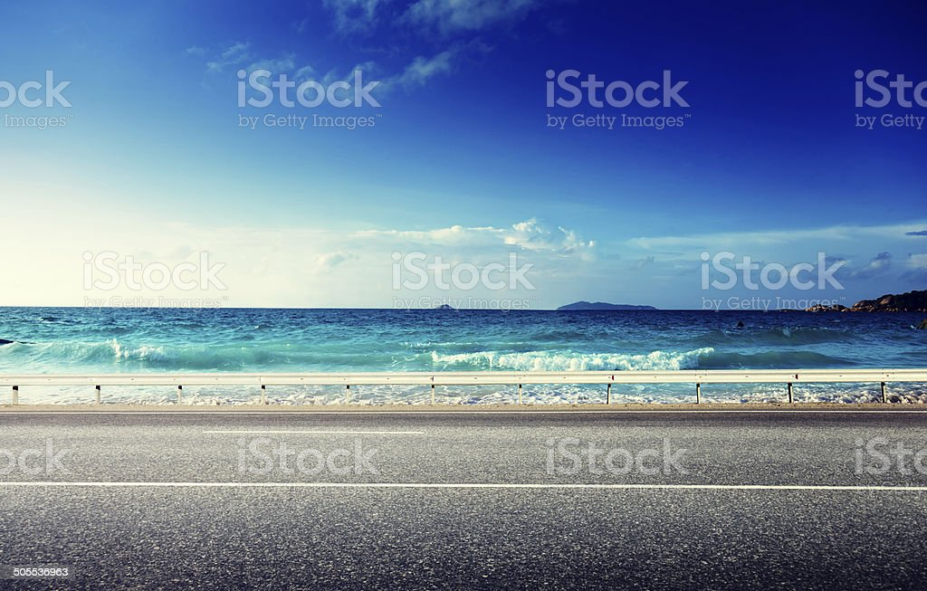 road and sea in sunset time stock photo