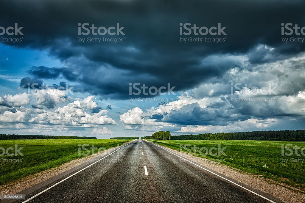 Road and stormy sky stock photo