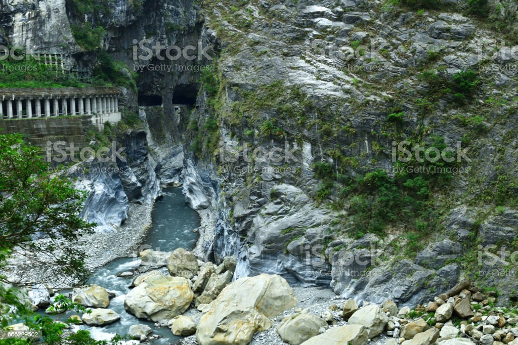 Road and tunnel pass through dangerous mountain valley stock photo