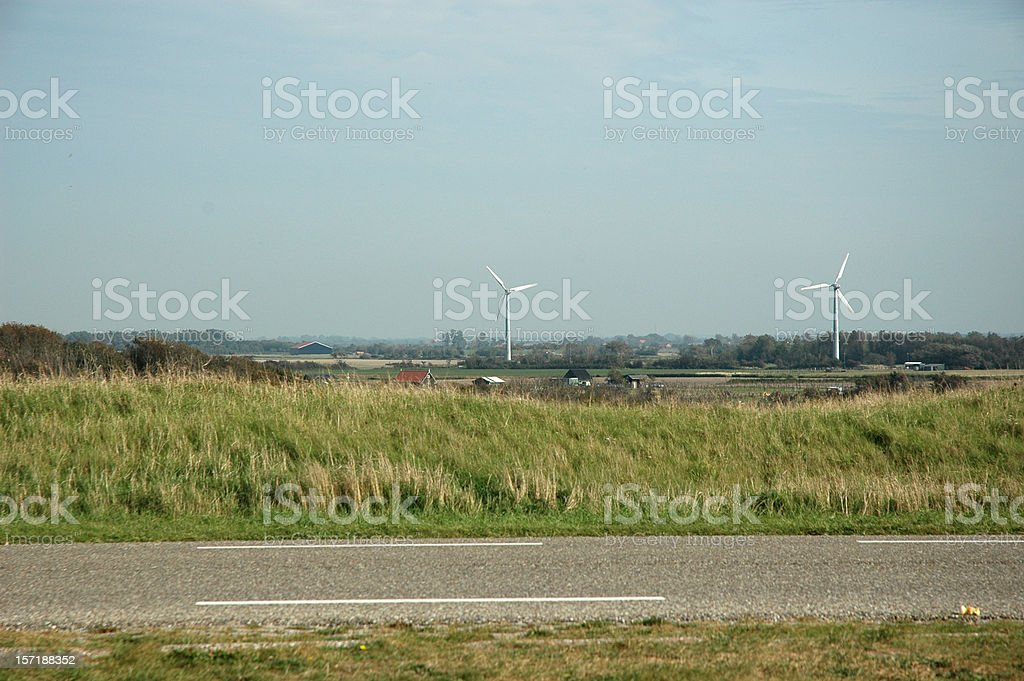 Road and windmills wind turbines royalty-free stock photo
